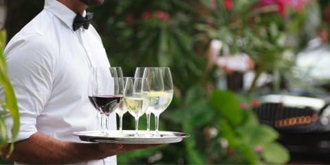 Drinks being served outside by a waiter at The Residences at The St. Regis Longboat Key