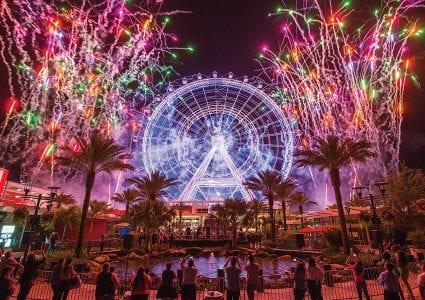 colorful fireworks on both sides of the Orlando eye ferris wheel
