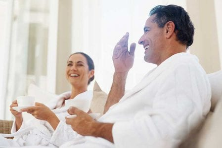 Couple in white robes at SPA at The Residences at The St. Regis Longboat Key Resort