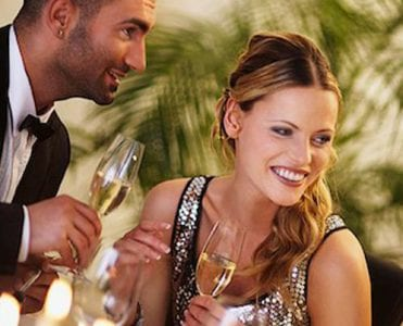 Man and woman with champagne flutes at an event at The Residences at The St. Regis Longboat Key