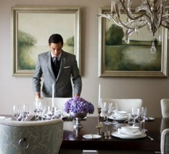 man setting table at The St Regis