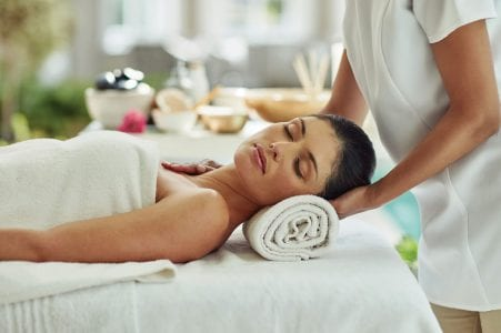 Woman getting a massage at The Residences at The St. Regis Longboat Key