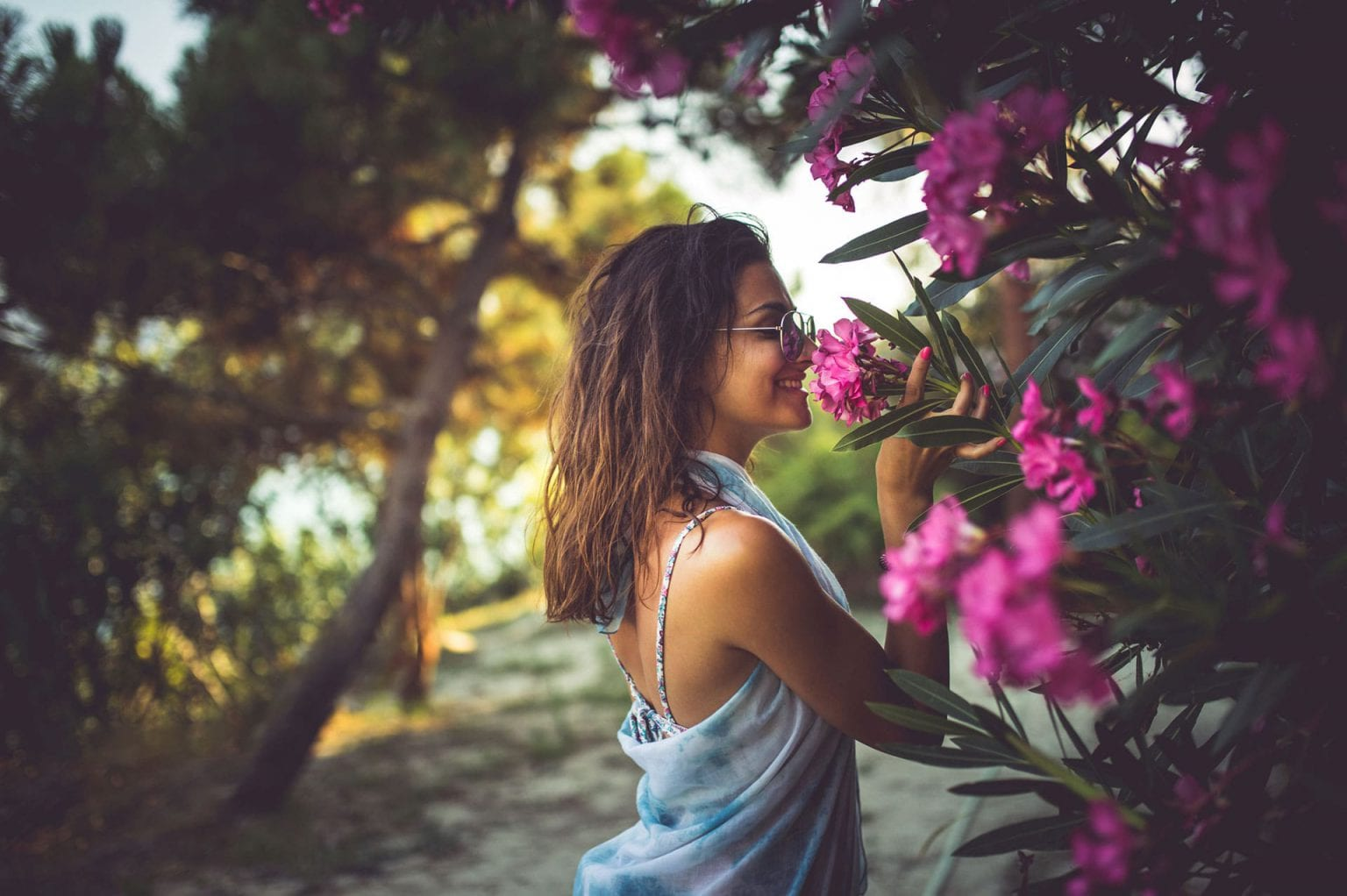 Woman Smelling Flowers at Longboat Key