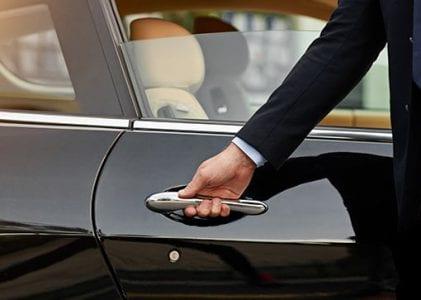 Man opening the car Door at The Residences at The St. Regis Longboat Key Resort