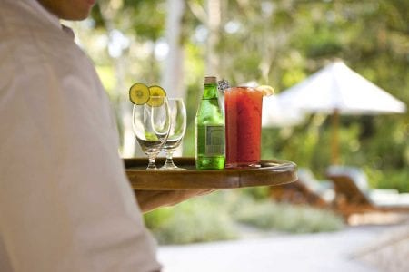 Waiter with a beverage tray at The St. Regis Longboat Key